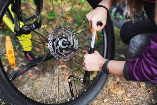pumping-bike-tires-hand-pump
