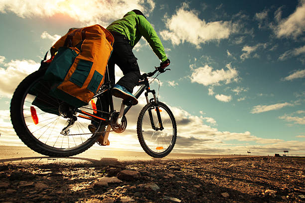 bicycle-tourist-with-loaded-bike-riding-on-an-empty-road